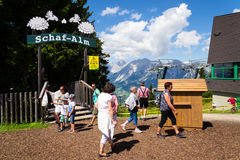 Tourists in front of Planai bike and ski areal on August 15, 2017 in Schladming, Austria. Stock Photos
