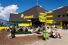 Tourists in front of Planai bike and ski areal on August 15, 2017 in Schladming, Austria. Royalty Free Stock Photography