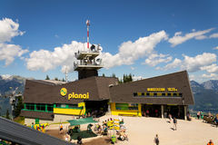 Tourists in front of Planai bike and ski areal on August 15, 2017 in Schladming, Austria. Stock Photo