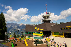 Tourists in front of Planai bike and ski areal on August 15, 2017 in Schladming, Austria. Stock Image