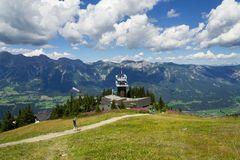 Tourists in front of Planai bike and ski areal in Schladming, Austria Stock Images