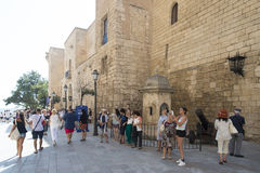 Tourists in front of the Royal Palace of La Almudaina. Stock Photography