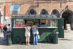 Tourists in front of a stand selling french fries in the market square in the center of Bruges, a beautiful medieval town in Belgi Stock Photos