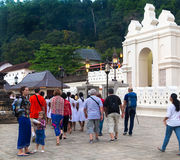 Tourists in front of The Temple of the Tooth Relic Royalty Free Stock Images