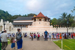 Tourists in front of The Temple of the Tooth Relic Stock Image