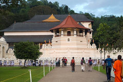 Tourists in front of The Temple of the Tooth Relic Stock Photo