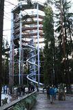 Tourists in front of tower of The trail trees Lipno Lookout. Tourist family in front of tower of The trail trees Lipno Lookout with stairs and slide in Czech Stock Image