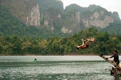 Tourists fun jumping water in Cheow Larn Lake (Ratchaprapa Dam), Royalty Free Stock Image