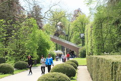 Tourists in gardens with revolving auditorium Royalty Free Stock Image