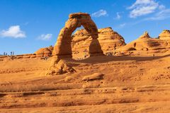 Tourists Gather Around Delicate Arch in Arches National Park. Tourists Gather Around Delicate Arch, one of the most popular arches in Arches National Park in royalty free stock photo