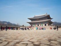 Tourists gather outside of Gyeongbokgung Palace. Stock Image