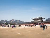 Tourists gather outside of Gyeongbokgung Palace. Stock Photos