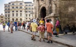 Tourists gather at St. Francis of Assisi Plaza in Havana. HAVANA, CUBA JUNE 19, 2016: Tourists gather outside the Basilica and Monastery of San Francisco de Asis royalty free stock image