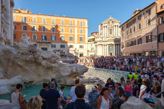 Tourists gather at the Trevi Fountai in Rome, Italy. Tourists gather at the famous Trevi Fountai in Rome stock photo