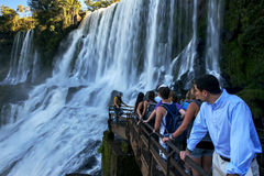 Tourists gather at a waterfall on the Argentinian side of the Iguazu Falls. Royalty Free Stock Photo