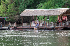 Tourists gathered to watch nature in the the River Kwai rafting. Royalty Free Stock Photos