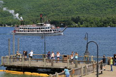 Tourists gathered on wharf,Lake George,New York,2014 Stock Image