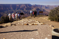 Tourists gaze over the South Rim. GRAND CANYON, ARIZONA - SEP 28 - Tourists gaze over the South Rim, on Sep 28, 2013 just before the government shutdown, at the Royalty Free Stock Image