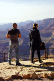 Tourists gaze over the South Rim Royalty Free Stock Photos