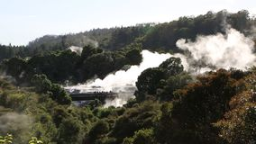 Tourists in geothermal valley stock footage
