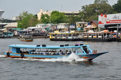 The tourists get on boat for sightseeing along Chao Phraya River Royalty Free Stock Photo