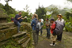 Tourists get history lesson on Ciudad Perdida. CIUDAD PERDIDA - NOVEMBER 28: Tourists visit Ciudad Perdida with guides in Colombian Jungle where protected by Stock Images