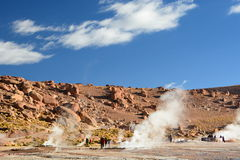 Tourists at geysers field. El Tatio. Antofagasta region. Chile Royalty Free Stock Images
