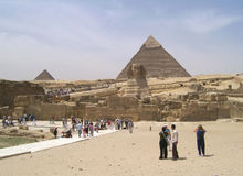 Tourists in Giza. Tourists visiting the Giza archaeological complex in Cairo, Egypt Royalty Free Stock Image