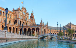 Tourists go boating on the channel on Plaza de Espana. In Seville, Spain Royalty Free Stock Photo