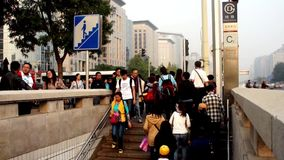 Tourists go downstairs to subway in Beijing. The visitors go downstairs to cross the Changan Avenue in Beijing, China stock footage