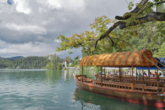 Tourists go for a ride on a boat on the Lake Bled. royalty free stock photography