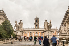 Tourists go up the stairs to the Palazzo Senators. Rome Stock Image