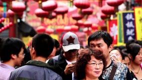 Tourists go into Wangfujing Snack Street stock video footage