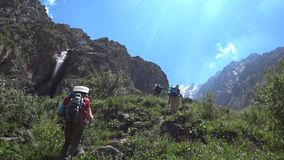 Tourists going to the waterfall. Travel, nature, people stock video footage