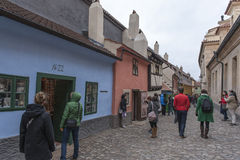 Tourists at the Golden Lane, Prague Castle. Tourists visiting the homes along the Golden Lane in Prague Castle. Franz Kafka once lived here - although it has stock photography
