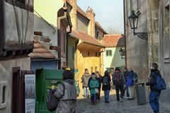 Tourists at the Golden Lane, Prague Castle. Tourists visiting the homes along the Golden Lane in Prague Castle. Franz Kafka once lived here - although it has royalty free stock photos