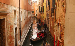 Tourists in gondola boats in Venice Stock Photo