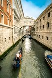 Tourists on a gondola on the canal of Venice stock images
