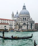 Tourists on gondola at Venice. Tourists on gondola boat at Venice for sightseeing, Italy Stock Image