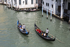 Tourists and gondolas in Venice, Italy Stock Photography