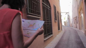 Tourists got lost on the narrow streets of the old city stock video