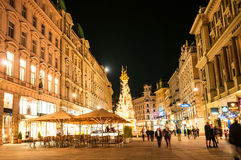Tourists on Graben Street in old town by night in Vienna, Austria Stock Image