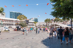 Tourists at Grand Casemates Square in Gibraltar. GIBRALTAR - AUGUST 27, 2014: Tourists at Grand Casemates Square. The square is lined with numerous pubs, bars Royalty Free Stock Photography