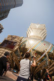 Tourists at the Grand Lisboa Casino in Macau. Stock Photography