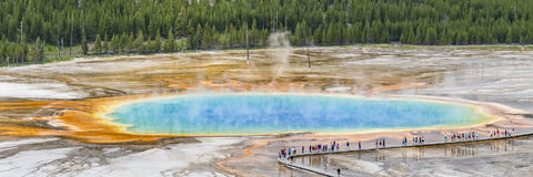 Tourists at Grand Prismatic Spring. Tourists line the boardwalk at the Grand Prismatic Spring in Midway Geyser Basin in Yellowstone National Park, Wyoming stock photography