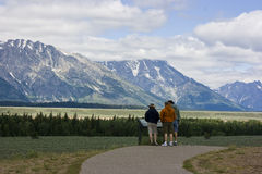 Tourists at The Grand Tetons Wyoming. A group of tourist read about the majestic Grand Teton Mountain range near Jackson Hole, Wyoming Royalty Free Stock Photography