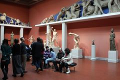 Tourists in the Greek room. Royalty Free Stock Photography