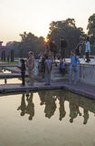 Tourists on the ground in front of the Taj Mahal in India Stock Images