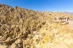 Tourists group  Moon Valley geological formations, La Paz cliffs. Tourists people group unique geological formations cliffs shapes, Moon Valley park, La Paz Stock Photo