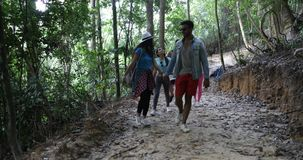 Tourists Group Trekking On Forest Path, Young Diverse Men And Woman On Hike Together. Slow Motion 60 stock video